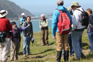 Toni Corelli explains the region's native plants to hikers