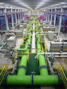 The inside of a reverse osmosis desalination plant. Photo by James Grellier via wikimedia commons